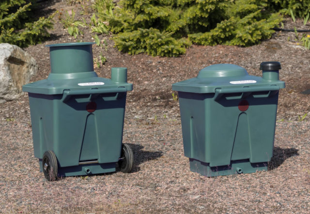 Green Toilet 120 Family and a spare container in Finland