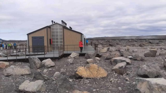 Tourists using the Green Toilet in Iceland